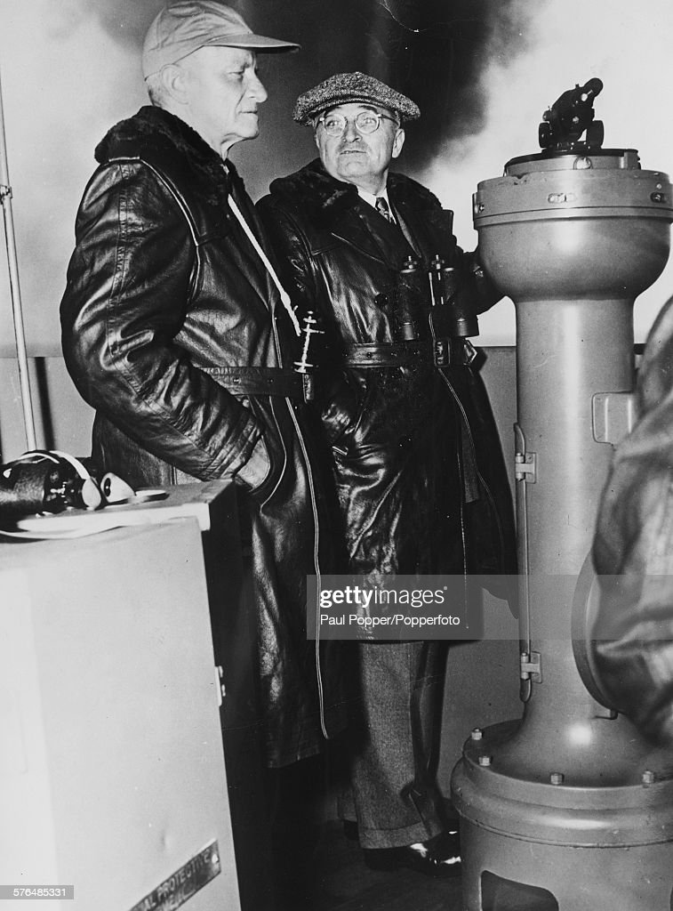 President of the United States, Harry S Truman (1884-1972) (right) with Fleet Admiral Chester W Nimitz (1885-1966) on the bridge of the giant aircraft carrier USS Franklin D Roosevelt (CV-42) as they watch military manuevers of the 8th Fleet off the Virgnia Capes, United States in 1945.