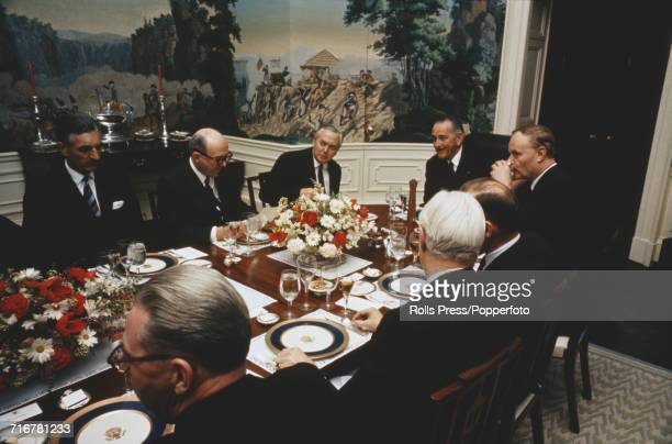 President of the United States Lyndon B Johnson 4th from left entertains Prime Minister of the United Kingdom Harold Wilson 3rd from left and...