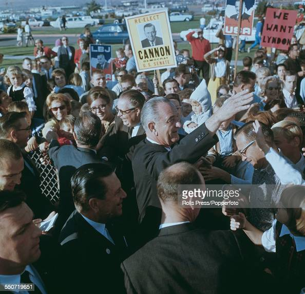 President of the United States Lyndon B Johnson pictured waving to supporters and crowds on the 1964 presidential election campaign trail in the...