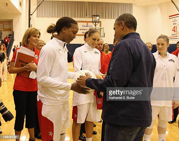 President of the United States of America Barack Obama meets with Tamika Catchings and Diana Taurasi of the 2012 US Women's Senior National Team...