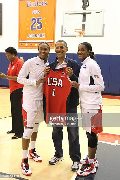 President of the United States of America Barack Obama with Tamika Catchings and Swin Cash of the 2012 US Women's Senior National Team following a...