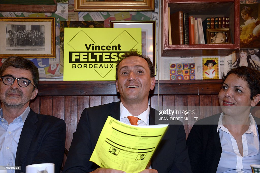 President of the Urban Community of Bordeaux (CUB) and Socialist Party candidate for the 2014 municipal elections Vincent Feltesse (C), flanked by his team members Olivier Bresse (L) and Naima Charai hold a press conference in a bar in Chartrons, Bordeaux, on June 20, 2013.