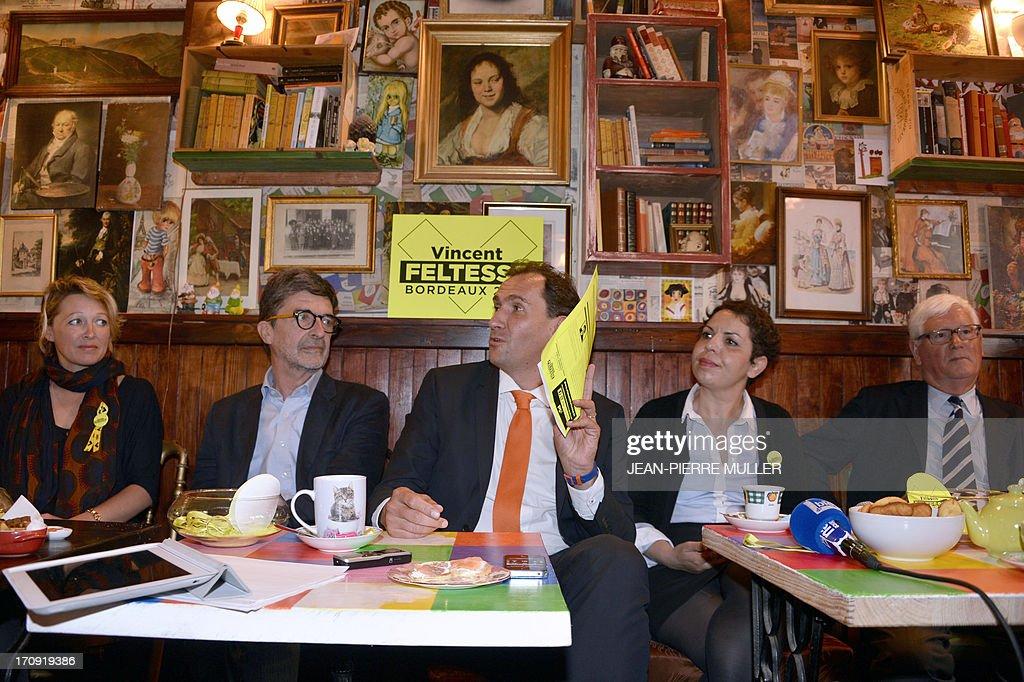President of the Urban Community of Bordeaux (CUB) and Socialist Party candidate for the 2014 municipal elections Vincent Feltesse (C), flanked by his team members Olivier Bresse (2nd L) and Naima Charai (2nd R) hold a press conference in a bar in Chartrons, Bordeaux, on June 20, 2013.