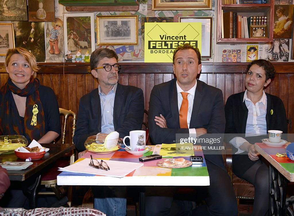 President of the Urban Community of Bordeaux (CUB) and Socialist Party candidate for the 2014 municipal elections Vincent Feltesse (C), flanked by his team members Olivier Bresse (2nd L) and Naima Charai (R) hold a press conference in a bar in Chartrons, Bordeaux, on June 20, 2013. AFP PHOTO / JEAN PIERRE MULLER