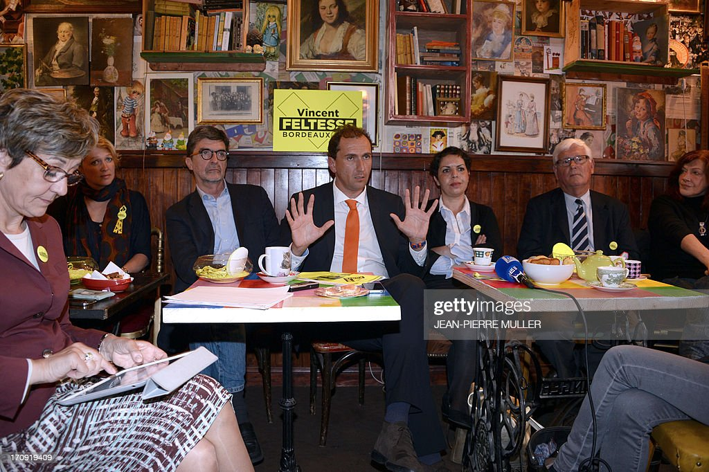 President of the Urban Community of Bordeaux (CUB) and Socialist Party candidate for the 2014 municipal elections Vincent Feltesse (C), flanked by his team members Olivier Bresse (3rd L) and Naima Charai (3rd R) hold a press conference in a bar in Chartrons, Bordeaux, on June 20, 2013.