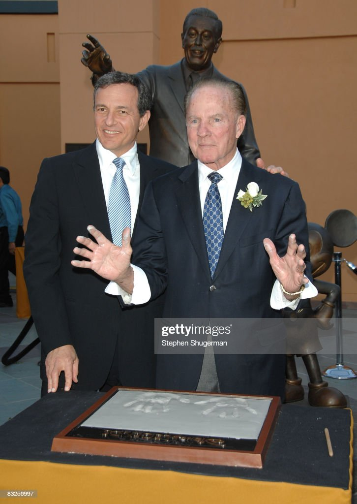 President of the Walt Disney Company Bob Iger (L) and TV commentator <a gi-track='captionPersonalityLinkClicked' href=/galleries/search?phrase=Frank+Gifford&family=editorial&specificpeople=214258 ng-click='$event.stopPropagation()'>Frank Gifford</a> attend the 2008 Disney Legends Ceremony at the Walt Disney Studios on October 13, 2008 in Burbank, California.