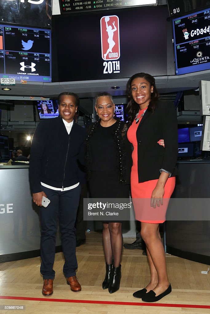 President of the WNBA Lisa Borders poses for photographs with basketball players Epiphanny Prince and Morgan Tuck after ringing the NYSE closing bell...