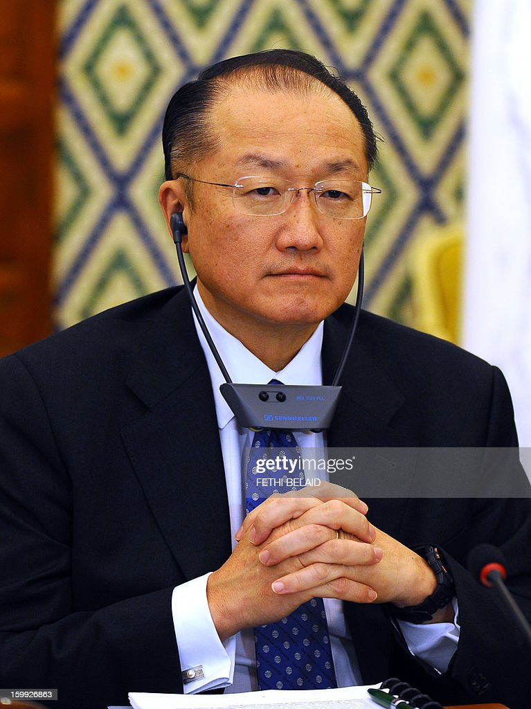 President of the World Bank Jim Yong Kim listens during his meeting with Tunisian Prime Minister Hamadi Jebali (unseen) on January 23, 2013 in Tunis. Kim is on 2 day official visit to Tunisia to discuss boosting economic growth.