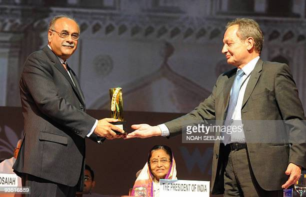 President of the World Editors Forum within the World Association of Newspapers Xavier VidalFolch presents the Golden Pen Award to editorinchief of...