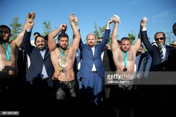 President of the World Ethnosport Confederation Bilal Erdogan poses for a photograph with wrestler during Ethnosports Culture Festival which takes...