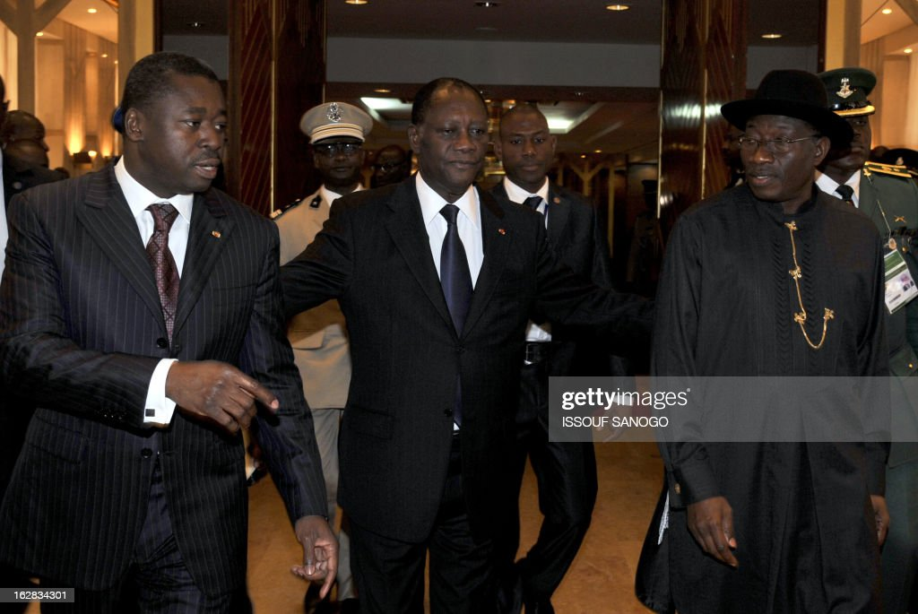 President of Togo Faure Gnassingbe, Ivory Coast president and ECOWAS chairman Alassane Ouattara (C) and Nigerian President Goodluck Johnathan arrive for the closing ceremony of ECOWAS heads of state ordinary summit on Febuary 28, 2013 at the Felix Houphouet-Boigny Fundation in Yamoussoukro.