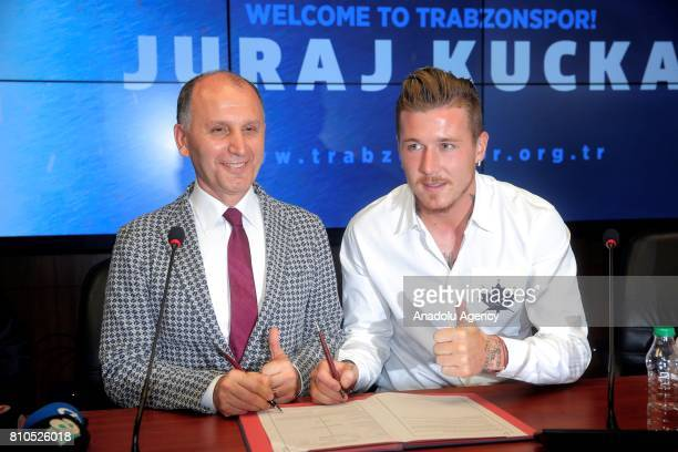 President of Trabzonspor Muharrem Usta and Trabzonspor's new transfer Slovakian footballer Juraj Kucka pose for a photo after a signing ceremony held...