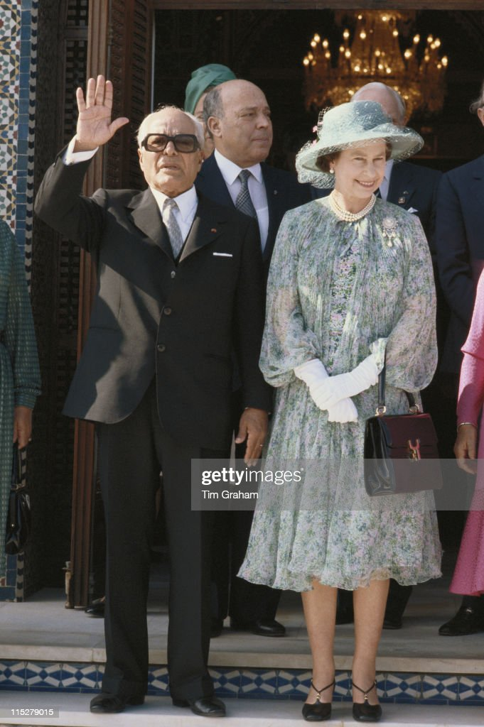 President of Tunisia, <a gi-track='captionPersonalityLinkClicked' href=/galleries/search?phrase=Habib+Bourguiba&family=editorial&specificpeople=213571 ng-click='$event.stopPropagation()'>Habib Bourguiba</a> (1903-2000) waving alongside Queen <a gi-track='captionPersonalityLinkClicked' href=/galleries/search?phrase=Elizabeth+II&family=editorial&specificpeople=67226 ng-click='$event.stopPropagation()'>Elizabeth II</a> during the Queen's state visit to Tunisia, 21 October 1980.