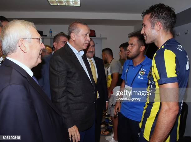 President of Turkey Recep Tayyip Erdogan and Chairman of Fenerbahce Aziz Yildirim congratulate Robin Van Persie of Fenerbahce after the UEFA Europa...