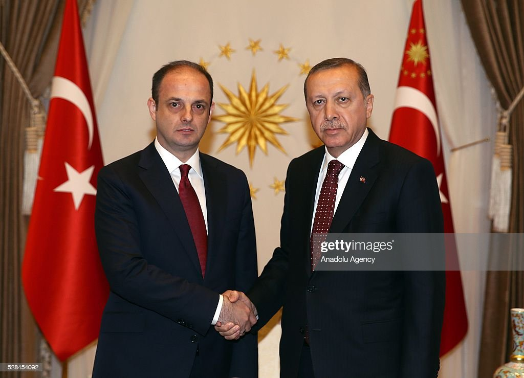 President of Turkey, Recep Tayyip Erdogan (R) and Governor of Turkish Central Bank, Murat Cetinkaya (L) shake each other's hands ahead of their meeting, at Presidential Complex, in Ankara, Turkey on May 5, 2016.