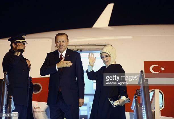 President of Turkey Recep Tayyip Erdogan and his wife Emine Erdogan gesture as they prepare to depart Antalya with the private plane 'ANA' following...