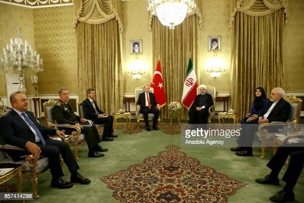 President of Turkey Recep Tayyip Erdogan and Iranian President Hassan Rouhani are seen with Chief of the General Staff of the Turkish Armed Forces...