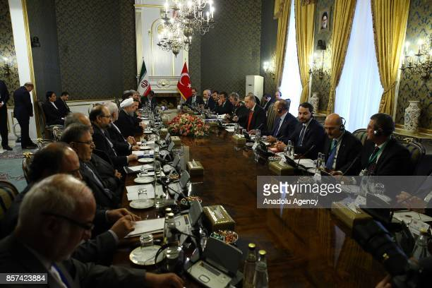 President of Turkey Recep Tayyip Erdogan and Iranian President Hassan Rouhani attend an inter delegations meeting at the Saadabad Palace in Tehran...