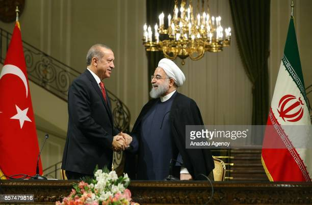 President of Turkey Recep Tayyip Erdogan and Iranian President Hassan Rouhani shake hands during a joint press conference after their meeting at the...