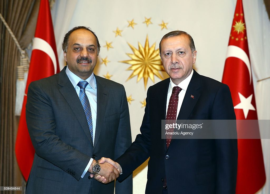 President of Turkey, Recep Tayyip Erdogan (R) and Minister of State for Defense of Qatar, Khalid bin Mohammad Al Attiyah (L) shake each other's hands ahead of their meeting, at Presidential Complex, in Ankara, Turkey on May 5, 2016.