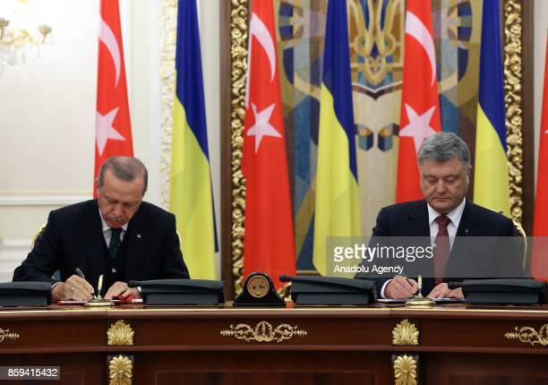 President of Turkey Recep Tayyip Erdogan and President of Ukraine Petro Poroshenko sign agreements during their meeting in Kiev Ukraine on October 09...