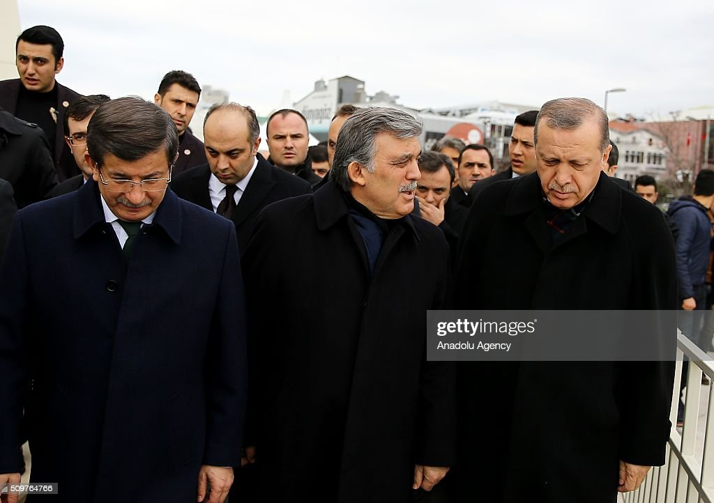 President of Turkey Recep Tayyip Erdogan (R) and Prime Minister of Turkey Ahmet Davutoglu (L) attend a funeral, held at the Mosque of Marmara University Theology Faculty for Ahmet Ozyurt, Turkey's 11th President Abdullah Gul's (C) father-in-law, in Istanbul, Turkey on February 12, 2016 .