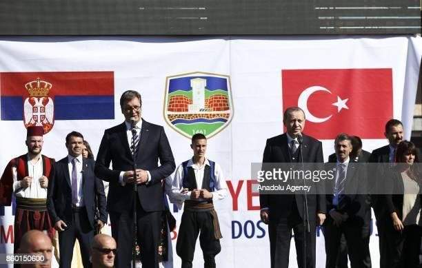 President of Turkey Recep Tayyip Erdogan and Serbian President Aleksandar Vucic greet people during their visit to southern Muslimmajority city of...