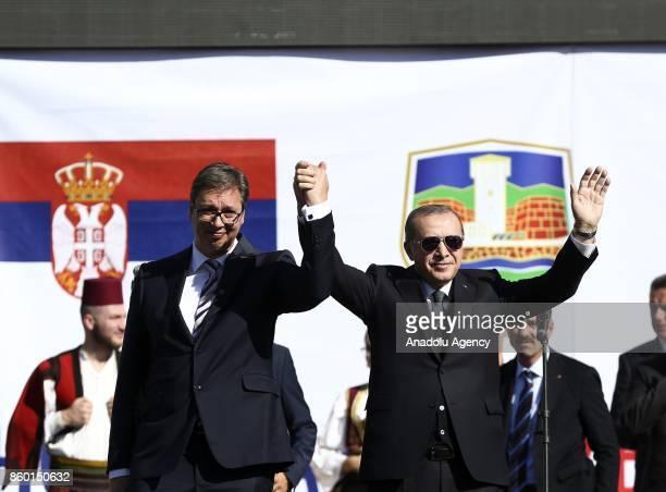 President of Turkey Recep Tayyip Erdogan and Serbian President Aleksandar Vucic greet crowd during their visit to southern Muslimmajority city of...