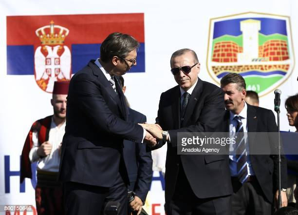 President of Turkey Recep Tayyip Erdogan and Serbian President Aleksandar Vucic shake hands during their visit to southern Muslimmajority city of...