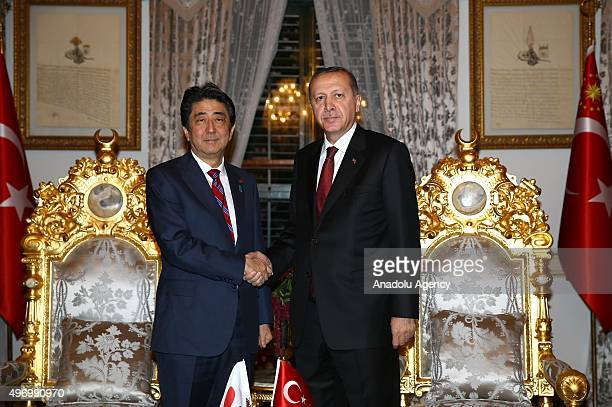 President of Turkey Recep Tayyip Erdogan and Shinzo Abe Prime Minister of Japan shake hands during their meeting at the Yildiz Palace State...