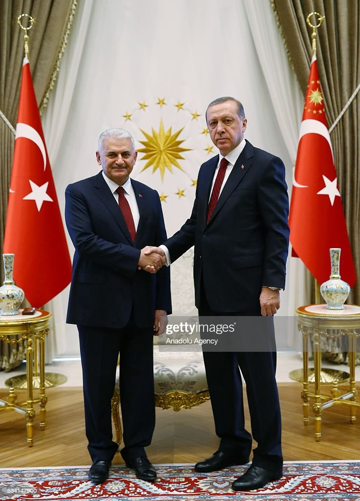 President of Turkey Recep Tayyip Erdogan (R) and Turkish Prime Minister Binali Yildirim (L) shake hands prior to the meeting of 65th Cabinet of Turkey at Presidential Complex, in Ankara, Turkey on May 25, 2016.
