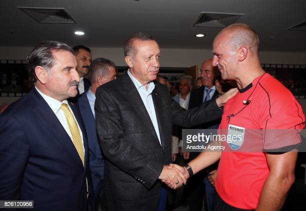President of Turkey Recep Tayyip Erdogan and Turkish Youth and Sports Minister Osman Askin Bak speaks with the referee of the match Robert Madley...