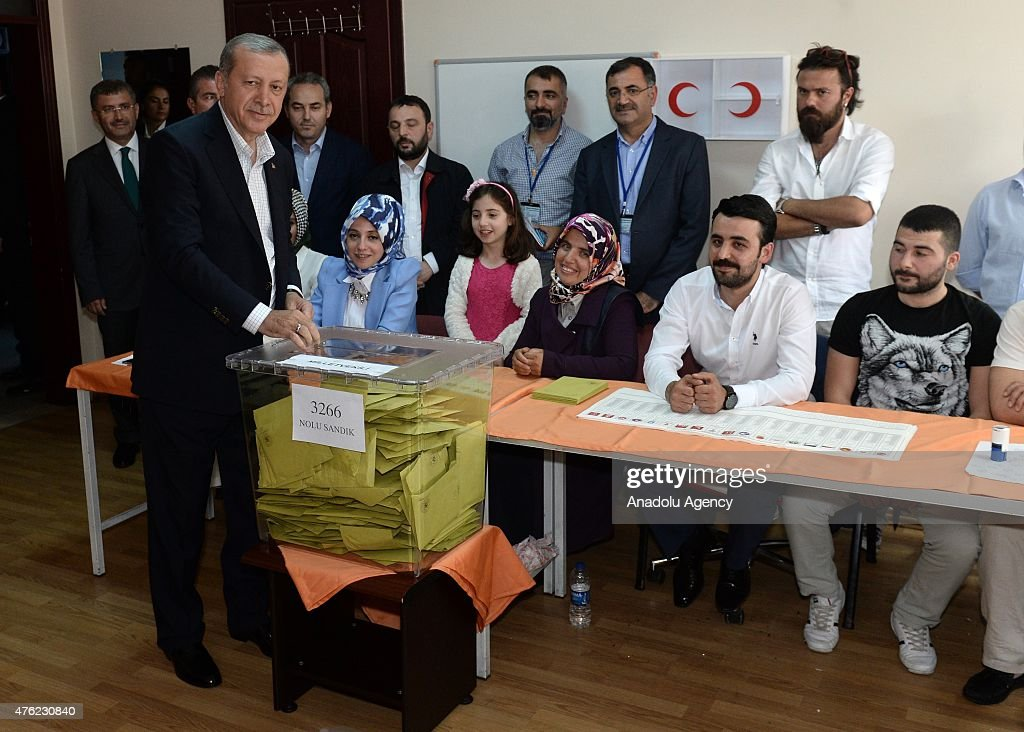 of Turkey Recep Tayyip Erdogan (L) casts his ballot in the Turkish ...