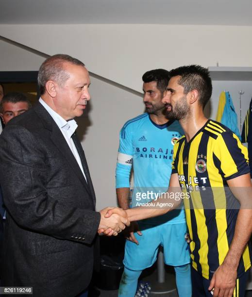 President of Turkey Recep Tayyip Erdogan congratulates Alper Potuk of Fenerbahce after the UEFA Europa League third qualifying round 2nd leg match...