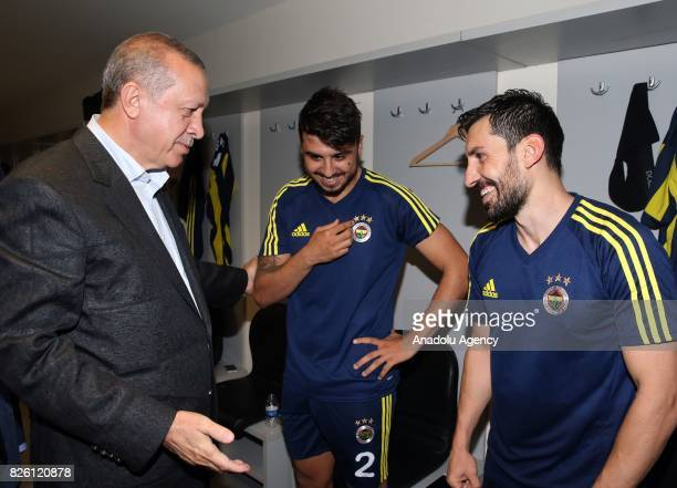 President of Turkey Recep Tayyip Erdogan congratulates football players of Fenerbahce after the UEFA Europa League third qualifying round 2nd leg...