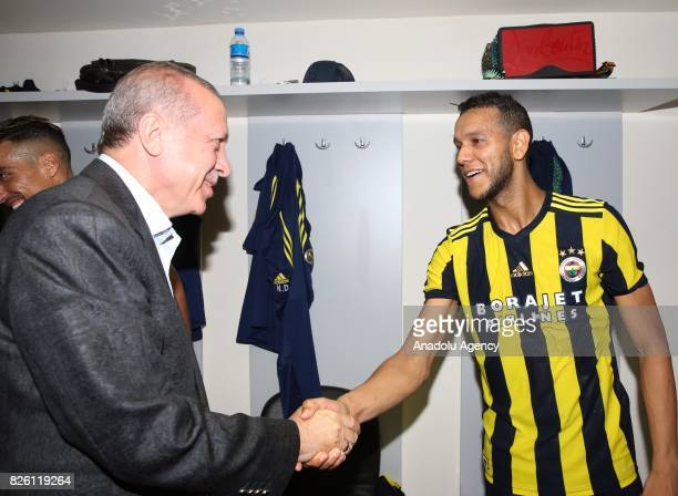 President of Turkey Recep Tayyip Erdogan congratulates Joseph De Souza of Fenerbahce after the UEFA Europa League third qualifying round 2nd leg...