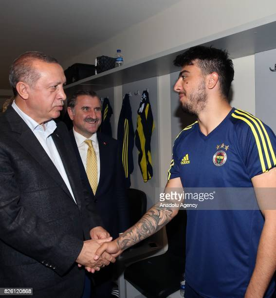 President of Turkey Recep Tayyip Erdogan congratulates Ozan Tufan of Fenerbahce after the UEFA Europa League third qualifying round 2nd leg match...