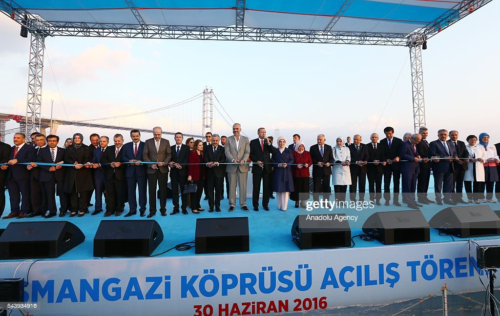 President of Turkey, Recep Tayyip Erdogan cuts the ribbon with his wife Emine Erdogan, Turkish Prime Minister Binali Yildirim, his wife Semiha Yildirim and Albanian Prime Minister Edi Rama during the opening ceremony of Osmangazi Bridge in Kocaeli, Turkey on June 30, 2016. Osmangazi Bridge is the fourth-longest suspension bridge in the world and second-longest bridge in Europe.