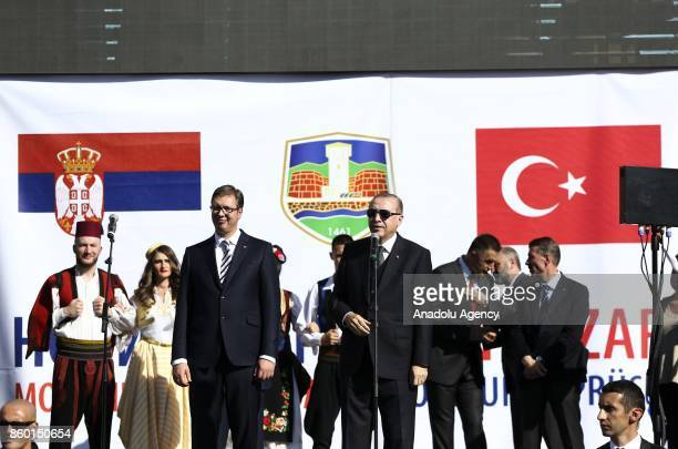 President of Turkey Recep Tayyip Erdogan delivers a speech as Serbian President Aleksandar Vucic stand next to him during their visit to southern...