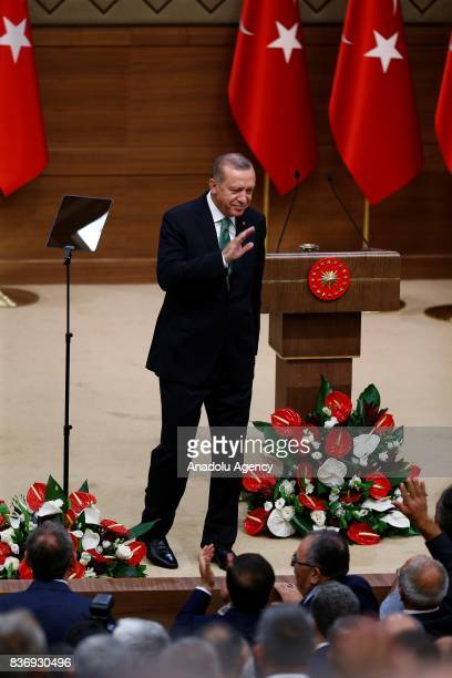 President of Turkey Recep Tayyip Erdogan greets participants during the 39th Mukhtars Meeting at Presidential Complex in Ankara Turkey on August 22...