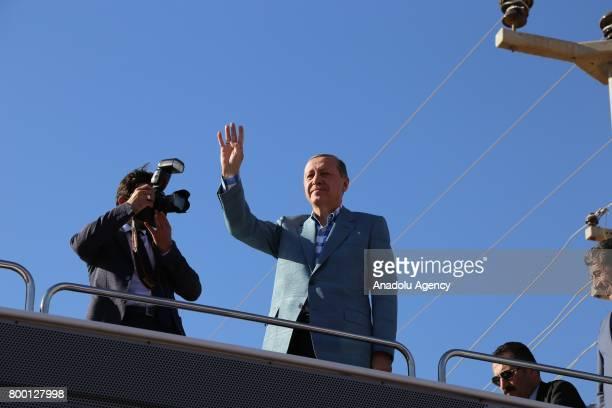 President of Turkey Recep Tayyip Erdogan greets the crowd at Ceylanpinar district of Sanliurfa Turkey on June 23 2017