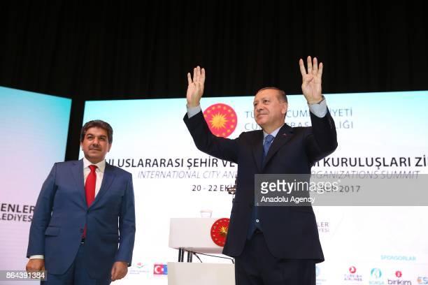President of Turkey Recep Tayyip Erdogan greets the crowd during the International City and Civil Society Organizations Summit at Yildiz Technical...