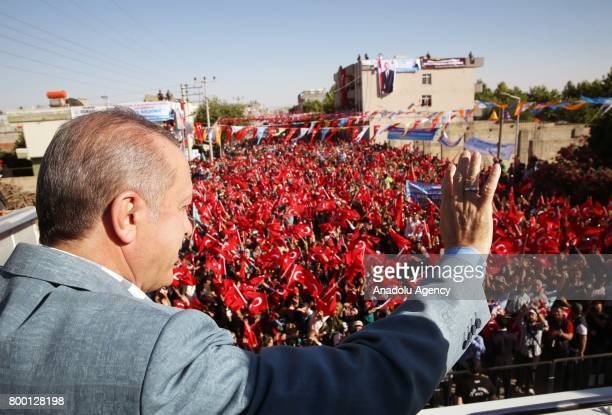 President of Turkey Recep Tayyip Erdogan greets the public at Ceylanpinar district of Sanliurfa Turkey on June 23 2017