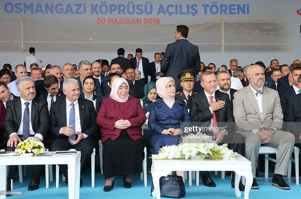 President of Turkey, Recep Tayyip Erdogan (2nd R), his wife Emine Erdogan (3rd R), Turkish Prime Minister Binali Yildirim (2nd L), his wife Semiha Yildirim (3rd L), Albanian Prime Minister Edi Rama (R) and Turkish Minister of Transport, Maritime and Communication Ahmet Arslan (L) attend the opening ceremony of Osmangazi Bridge in Kocaeli, Turkey on June 30, 2016. Osmangazi Bridge is the fourth-longest suspension bridge in the world and second-longest bridge in Europe.