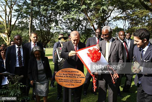 President of Turkey Recep Tayyip Erdogan is seen together with DirectorGeneral of the United Nations Office at Nairobi SahleWork Zewde after planting...