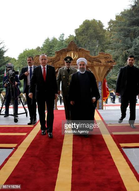 President of Turkey Recep Tayyip Erdogan is seen together with Iranian President Hassan Rouhani during an official welcoming ceremony at the Saadabad...