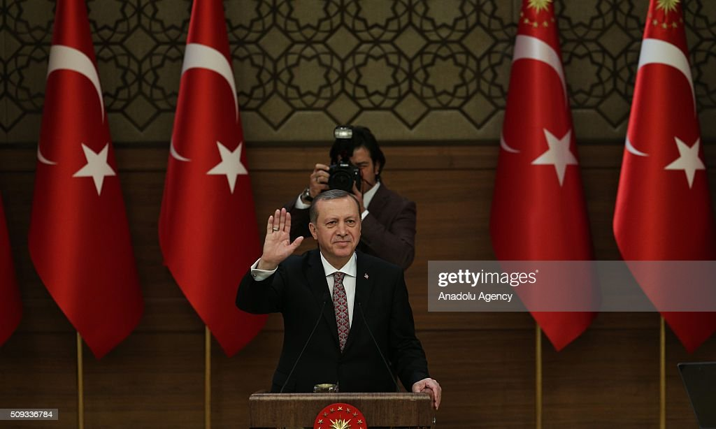 President of Turkey, Recep Tayyip Erdogan salutes participants during monthly 'Mukhtars (local administrators) meeting' at Presidential Complex in Ankara, Turkey on February 10, 2016.