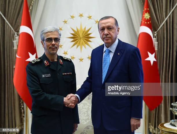 President of Turkey Recep Tayyip Erdogan shakes hands with General Staff of the Armed Forces of Iran Mohammad Bagheri ahead of their meeting at...