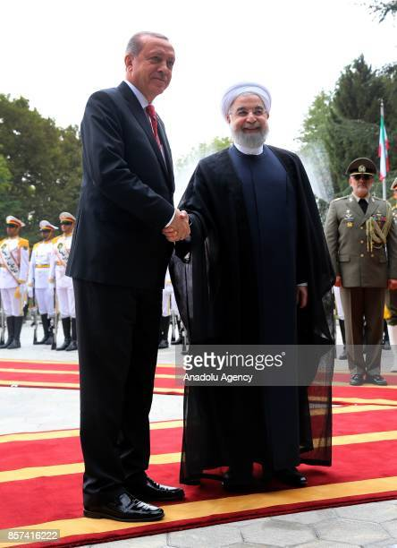 President of Turkey Recep Tayyip Erdogan shakes hands with Iranian President Hassan Rouhani during an official welcoming ceremony at the Saadabad...