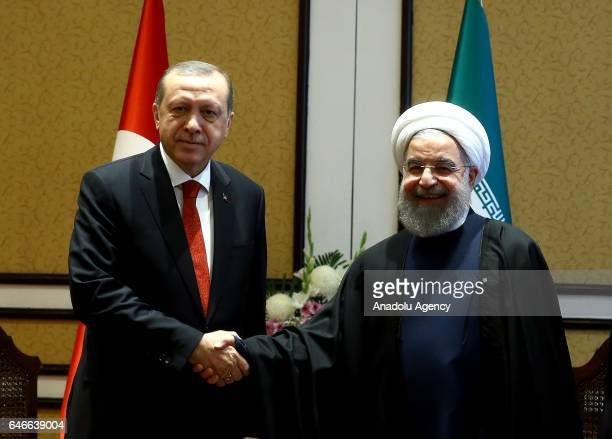 President of Turkey Recep Tayyip Erdogan shakes hands with President of Iran Hassan Rouhani before their meeting as the 13th Economy Cooperation...